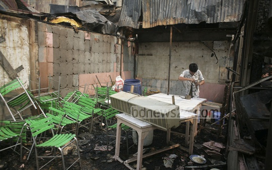 Fire victims on Monday search for their belongings among the debris after a fire gutted Hasina Market at capital's Kawran Bazar on Sunday.