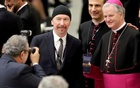 U2 guitarist David Evans, also known by his stage name The Edge, poses with Irish bishop Paul Tighe (R) before listening to U.S. Vice President Joe Biden in Paul VI hall at the Vatican April 29, 2016. Reuters