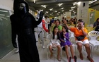 Members of a Star Wars fan club in Thailand, dressed as Kylo Ren, entertains children during Star Wars Day celebration at the Queen Sirikit National Institute of Child Health in Bangkok, Thailand, May 4, 2016. Reuters