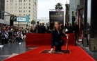 Actress Jodie Foster touches her star after it was unveiled on the Hollywood Walk of Fame in Hollywood, U.S., May 4, 2016. Reuters