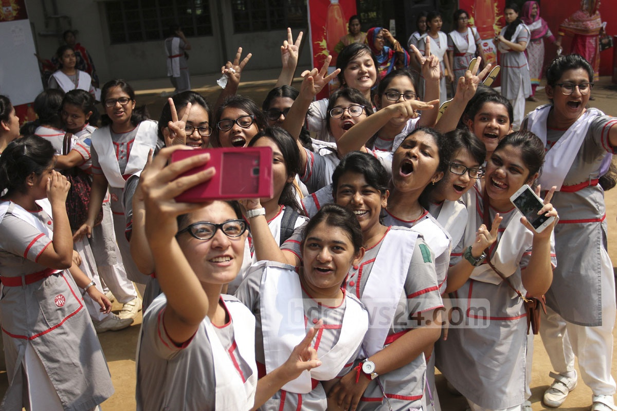 Jubillant students take of the Holy Cross School and College in Dhaka selfies on Wednesday after getting GPA-5 in the SSC exam. Photo: asif mahmud ove