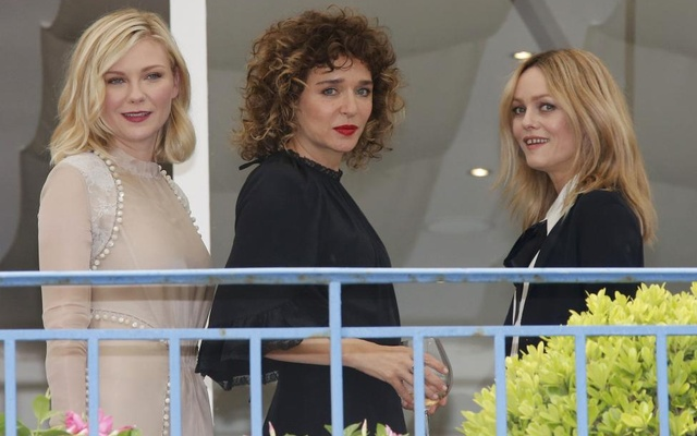 Jury members actress Kirsten Dunst (L), actress Valeria Golino (C) and actress and singer Vanessa Paradis stand on the terrace at the Grand Hyatt Cannes Hotel Martinez on the eve of the opening of the 69th Cannes Film Festival in Cannes, France, May 10, 2016. Reuters