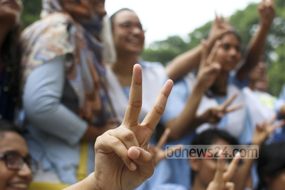Students of the Viqarunnisa Noon School in Dhaka flash the victory sign after getting GPA-5 in the SSC exam. Photo: abdul mannan