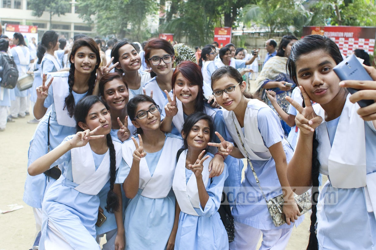 Jubillant students take of the Viqarunnisa Noon School in Dhaka selfies on Wednesday after getting GPA-5 in the SSC exam. Photo: abdul mannan