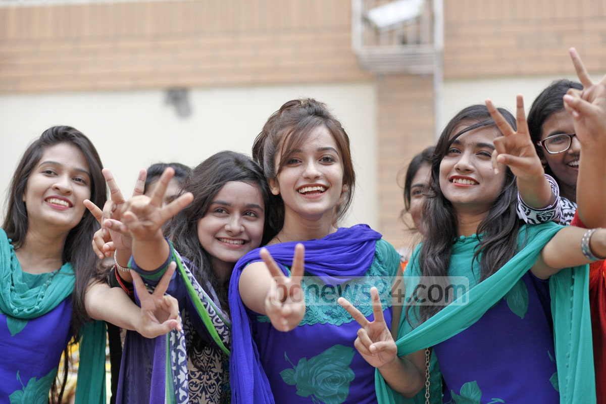 Students of the Monipur high school and college in Dhaka flash the victory sign after getting GPA-5 in the SSC exam. Photo: nayan kumar