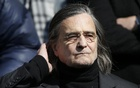 French actor Jean-Pierre Leaud leaves after the funeral ceremony of late film director Alain Resnais at the Saint-Vincent-de-Paul church in Paris, France, March 10, 2014. Reuters