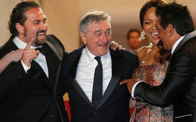 Director Jonathan Jacubowicz, cast member Robert De Niro and former boxer Roberto Duran pose on the red carpet as they arrive for the screening of the film
