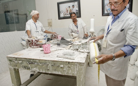 Experts busy working to give shape to artificial limbs for amputees. Photo: tanvir ahammed