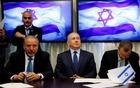 Avigdor Lieberman, head of far-right Yisrael Beitenu party, (L) sits next to Israeli Prime Minister Benjamin Netanyahu (C) as they sign a coalition deal to broaden the government's parliamentary majority, at the Knesset, the Israeli parliament in Jerusalem May 25, 2016. Reuters