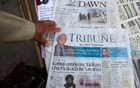 Newspapers containing news about Afghan Taliban leader Mullah Akhtar Mansour are on display at a stall in Peshawar, Pakistan, May 23, 2016. Reuters