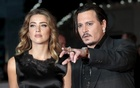Cast member Johnny Depp and his actress wife Amber Heard arrive for the premiere of the British film ''Black Mass'' in London, Britain October 11, 2015. Reuters