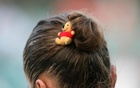 A girl wears a Winnie-the-Pooh teddy bear in her hair in London June 30, 2006. Reuters