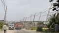 Bamboo poles are used to support overhead electric transmission lines along around one kilometer stretch of Banasree Staff Quarters Link Road. Local residents claim this hazardous work has been done in the knowledge of DESCO authorities.