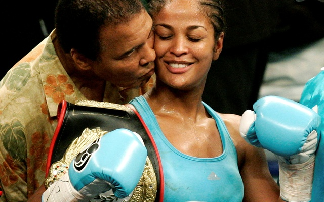 Muhammad Ali with his daughter Laila Ali, WBC and WIBA super middleweight champion, at the MCI Center in Washington in this June 11, 2005 file photo. Reuters