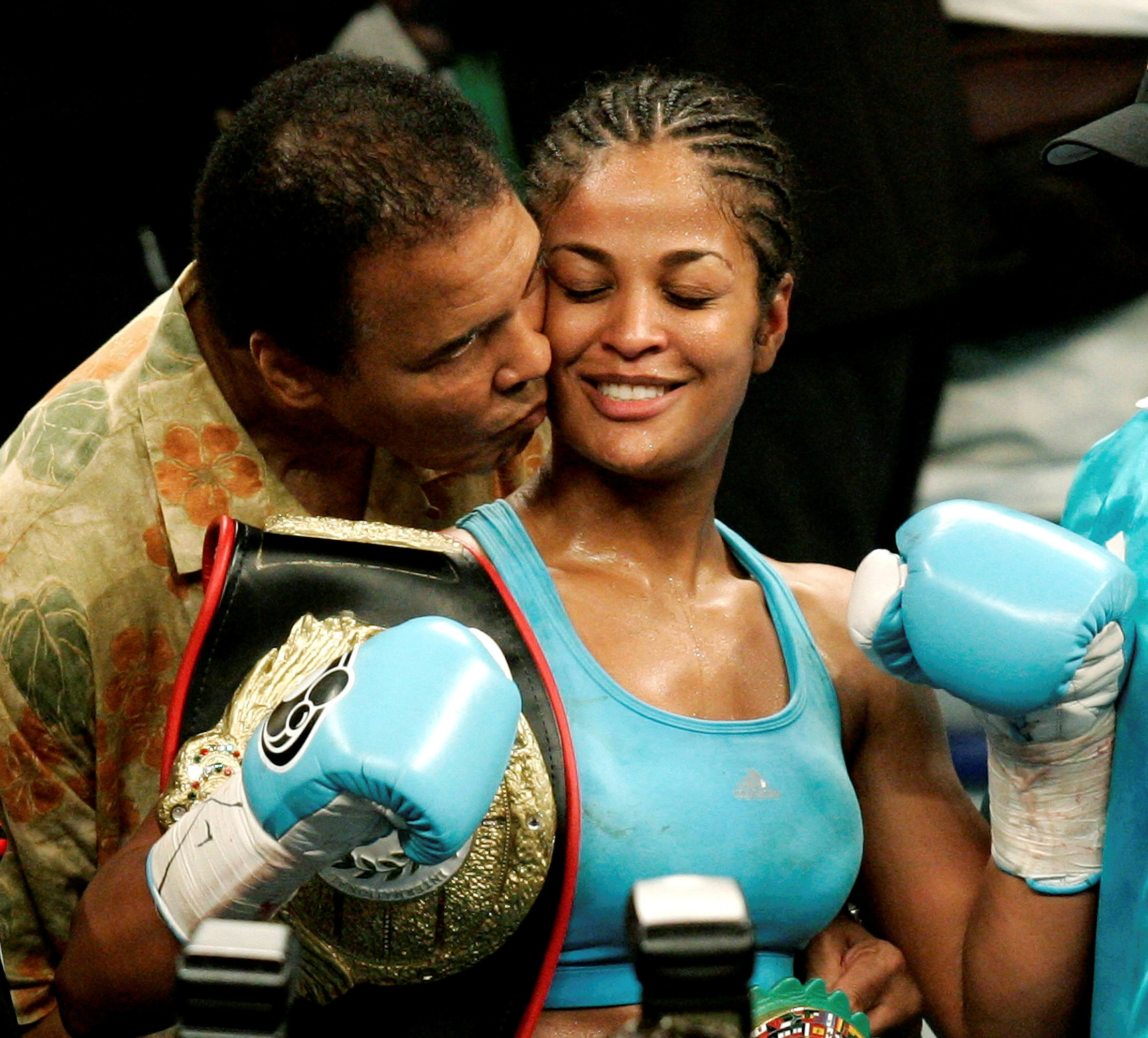 With daughter Laila Ali, a WBC and WIBA super middleweight champion. Reuters