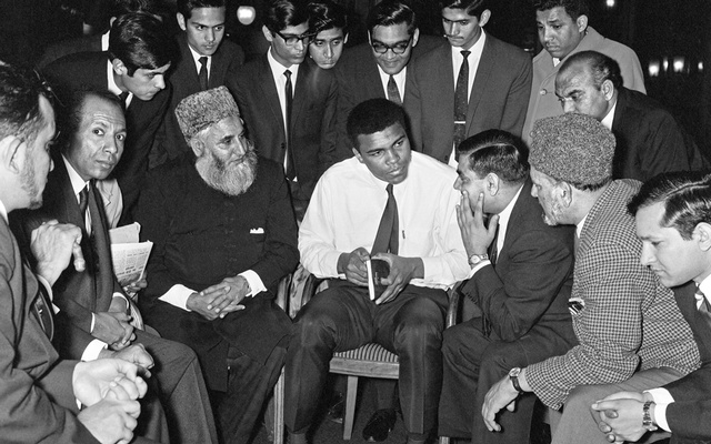 Muhammad Ali (formerly Cassius Clay) speaks to Muslims holding a book called Towards Understanding Islam written by Sayyid Abul Ala Maududi in London, Britain in May 1966. Ali was in London for of his rematch with British Heavyweight Henry Cooper. Photo: Action Images / MSI/File Photo