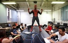 Moises Vazquez, 26, known as Spider-Moy, a computer science teaching assistant at the Faculty of Science of the National Autonomous University of Mexico (UNAM), who teaches dressed as a comic superhero Spider-Man, poses for a photograph during a class in Mexico City, Mexico, May 27, 2016. Reuters