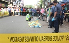 Mahmuda was attacked while taking her son to catch the school bus. People gather as police cordon off the murder scene at GEC Intersection on Sunday morning.