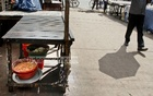 Ingredients for Iftar are left open on a footpath at the Dhaka University campus. Photo: tanvir ahammed
