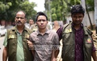 Detective Branch officials on Thursday escort to court Sumon Hossain Patwary arrested on charge of attacking publisher Ahmedur Rashid Tutul.