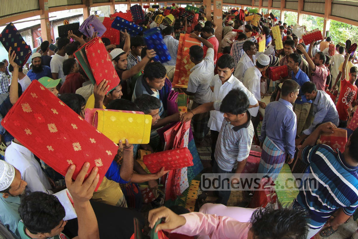 Retailers crowd a wholesale market of Jamdani saree at Demra on Friday.