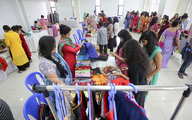 Visitors at the 'Rangta' fair, organised by women entreprenuers' forum, 'Meye', take look at the products on the first day of the exhibition on Friday. Photo: asaduzzaman pramanik