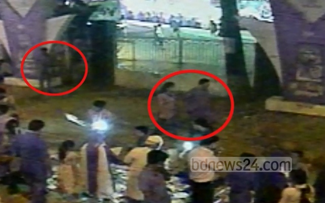 Sreengrab from CCTV footage released by police shows Avijit Roy and his wife Rafida Ahmed Bonya (circled in red on the right) and a man (circled in red) following them on the night of Feb 26, 2015.