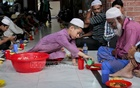 A child serving Iftar.