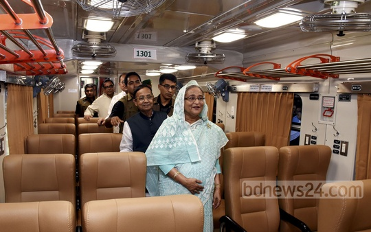 Prime Minister Sheikh Hasina takes a look inside a coach after launching the Dhaka-Chittagong non-stop 'Sonar Bangla Express' at the Kamalapur station on Saturday. Photo: Saiful Islam Kallol