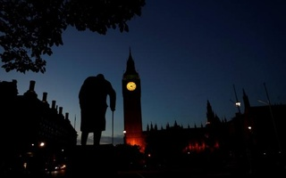 Dawn breaks behind the Houses of Parliament and the statue of Winston Churchill in Westminster, London, Britain, June 24, 2016. Reuters
