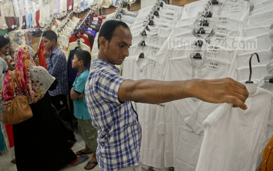 Customers browse dresses for Eid at Elephant Road on Sunday. Photo: tanvir ahammed