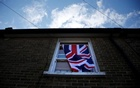 A British flag flutters in front of a window in London, Britain, June 24, 2016 after Britain voted to leave the European Union in the EU BREXIT referendum. Reuters