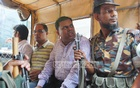 Law enforcers arrest a trader at the order of a mobile court at Chittagong's Khatunganj on Monday for selling sugar at a price higher than fixed by the government.