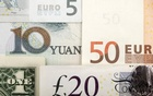 Arrangement of various world currencies including Chinese Yuan, US Dollar, Euro, British Pound, pictured January 25, 2011 Reuters
