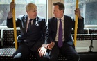 FILE PHOTO: Britain's Prime Minister David Cameron (R) and London Mayor Boris Johnson sit on an underground train as they head to Westminster after local election campaigning in Harrow, London May 12, 2014. Reuters