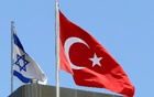 A Turkish flag flutters atop the Turkish embassy as an Israeli flag is seen nearby, in Tel Aviv, Israel June 26, 2016. Picture taken June 26, 2016. Reuters