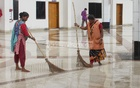 Workers clean the ground floor of the Kamalapur rail station, as the authorities launch a clean-up drive ahead of Eid-ul-Fitr. The photo was taken on Tuesday.