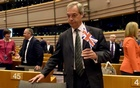 Nigel Farage, the leader of the United Kingdom Independence Party, holds the British flag as he attends a plenary session at the European Parliament on the outcome of the ''Brexit'' in Brussels, Belgium, June 28, 2016. Reuters