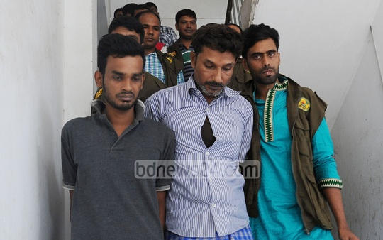 'Shahjahan' (left) and Saidul Alam Shikder, arrested over the murder of SP Babul Aktar's wife, being taken to the Detective Branch office from Chittagong Metropolitan Police Headquarters on Friday. Photo: suman babu