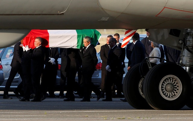 A coffin containing the body of one of the nine Italians killed in the Bangladesh attack is carried by pallbearers as it is disembarked from an Italian airplane at Ciampino military airbase, south of Rome, Italy, July 5, 2016. Reuters