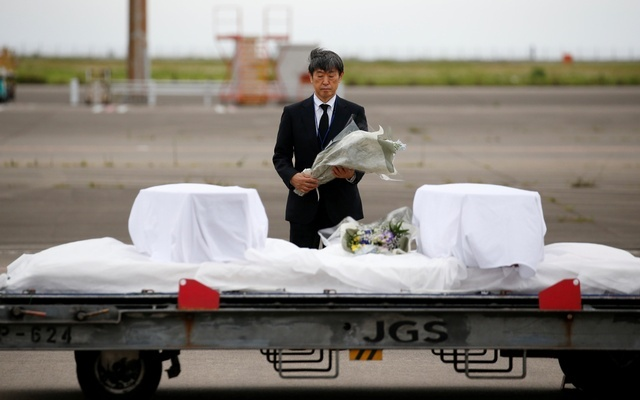 Six of the seven Japanese nationals killed in the Jul 1 attack on a Gulshan cafe were surveyors of Dhaka's Metrorail, a project funded by JICA. On Tuesday, JICA President Shinichi Kitaoka offers flowers to coffins containing the bodies at Haneda airport in Tokyo. Reuters