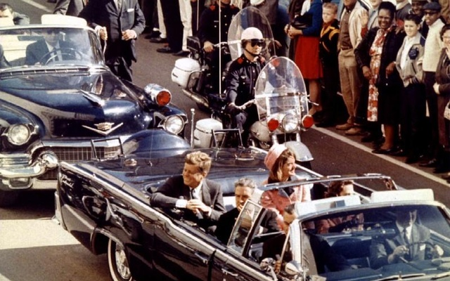President John F. Kennedy, first lady Jacqueline Kennedy, and Texas Governor John Connally ride through Dallas moments before Kennedy was assassinated, November 22, 1963. Reuters