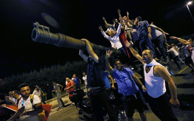 People stand on a Turkish army tank at Ataturk airport in Istanbul, Turkey July 16, 2016. Reuters