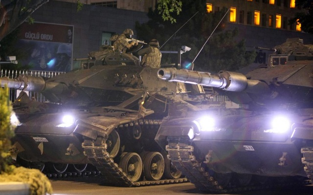 A military aims his weapon on top of a tank during an attempted coup in Ankara, Turkey July 16, 2016. Reuters