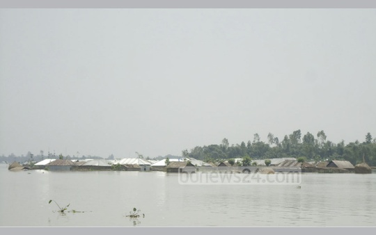 The low-lying areas of Kurhigram are flooded due to a rise in the water level of the Brahmaputra and other rivers following heavy rain and increased upstream flow. The photo has been taken at Char Bhagabatipur in the Kurhigram Jatrapur Union.