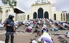 Police stand guard as Muslims offer Juma prayers at Baitul Mukarram National Mosque on Friday. Photo: nayan kumar