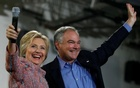 Democratic US presidential candidate Hillary Clinton and US Senator Tim Kaine (D-VA) wave to the crowd during a campaign rally at Ernst Community Cultural Center in Annandale, Virginia, US, July 14, 2016. Reuters