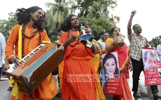 Cultural activists congregate to protest militancy at Shaheed Minar. Photo: asif mahmud ove