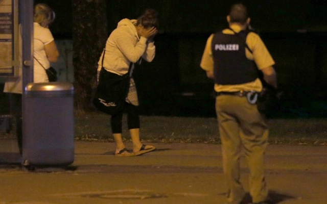 A woman reacts following a shooting rampage at the Olympia shopping mall in Munich. Reuters