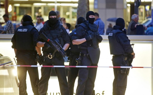 Special force police officers stand guard at an entrance of the main train station, following a shooting rampage at the Olympia shopping mall in Munich. Reuters